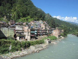 Passing a river town in Tibet