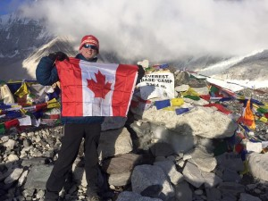 Kenn Charlton with the Canadian flag at Everest base camp