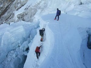 Ladder climbing in the Khumbu Icefall.