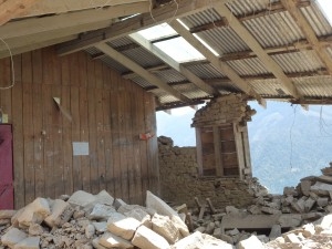 Seriously damaged building in Goli village