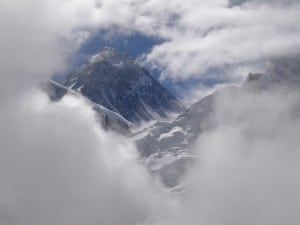 Everest showing up behind the clouds