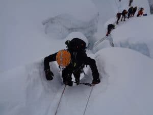 The glacier on Island peak can be challenging with ladder crossings