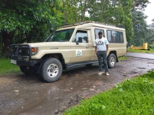 Athumani showing off his new Safari vehicle