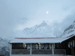 The moon out over Machhapuchare Mountain